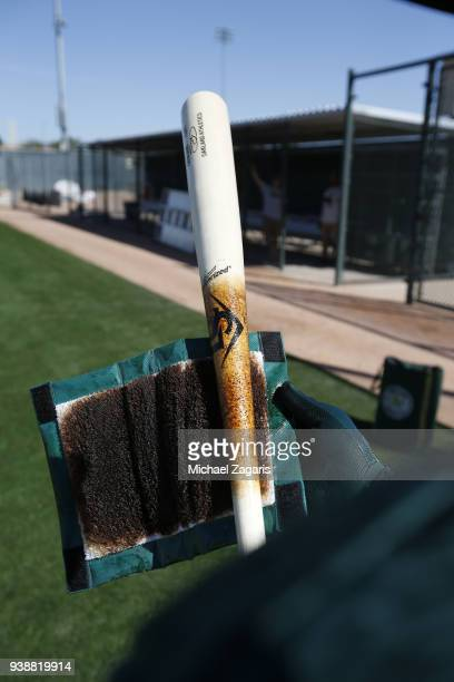 A members of the Oakland Athletics puts pine tar on his bat during a spring training workout at Fitch Park on February 21 2018 in Mesa Arizona