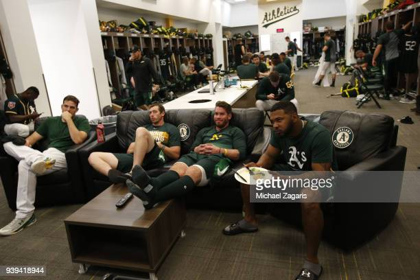 Members of the Oakland Athletics relax in the clubhouse prior to the game against the Los Angeles Angels of Anaheim at Hohokam Stadium on February 23...