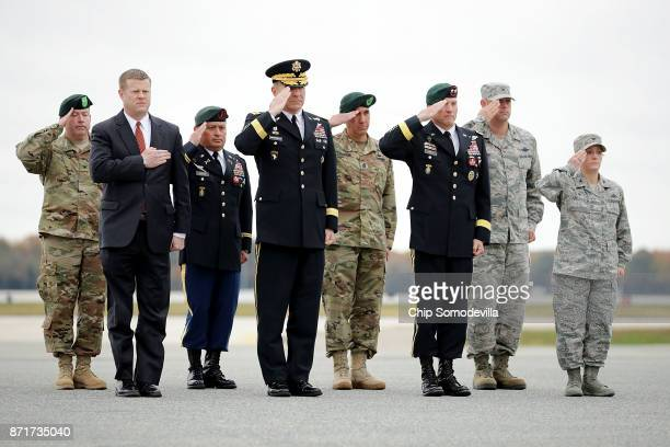 Members of the official party, including Acting Secretary of the Army Ryan McCarthy, Army Special Operations Command Chief Warrant Officer 5...
