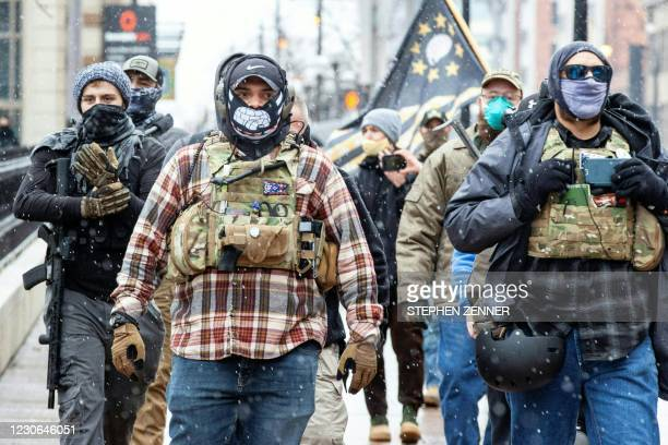 Members of the Ohio Boogaloo movement gather near the Ohio Statehouse in Columbus, Ohio on January 17, 2021 during a nationwide protest called by...