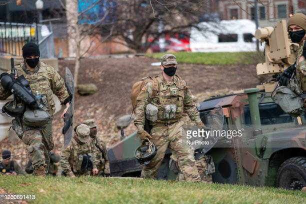 Members of the Ohio National Guard arrive to provide security as demonstrations and protests are expected to take place at the Ohio Statehouse as...