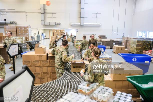 Members of the Ohio National Guard help to pack food and supplies for those in need at the Mid Ohio Foodbank in Columbus Due to the ongoing...
