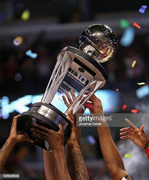 Members of the Ohio State Buckeyes hold the trophy after winning the Big Ten Basketball Tournament Championship against the Wisconsin Bagers at...