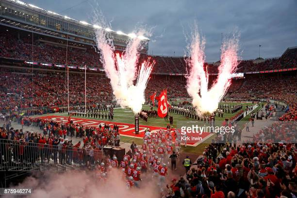 Members of the Ohio State Buckeyes run out on to the field prior to the start of the game against the Illinois Fighting Illini on November 18 2017 at...