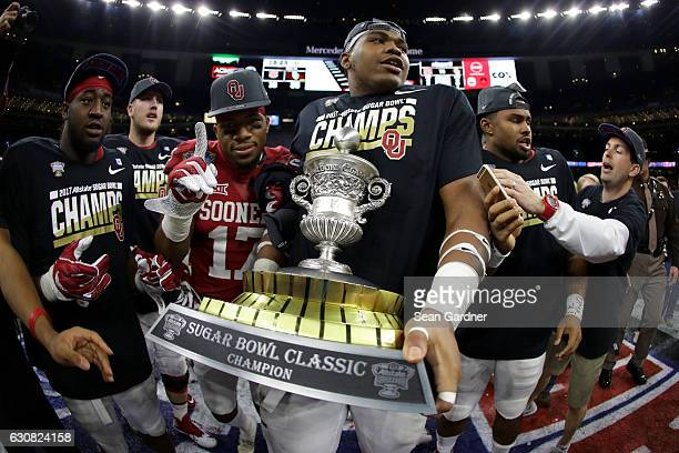 Members of the Oklahoma Sooners celebrate after defeating the Auburn Tigers 3519 during the Allstate Sugar Bowl at the MercedesBenz Superdome on...