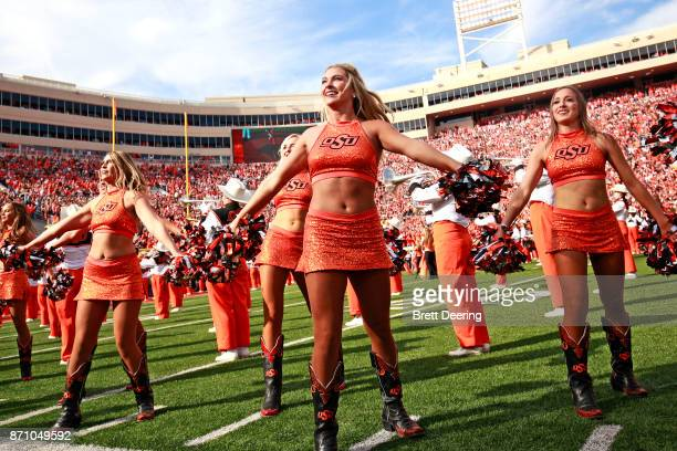 Members of the Oklahoma State Cowboys spirit squad perform before the game against the Oklahoma Sooners at Boone Pickens Stadium on November 4 2017...