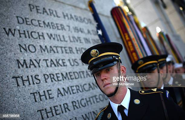 Members of the 'Old Guard' wait to present the colors at a Veterans Day ceremony at the World War Two Memorial November 11 2014 in Washington DC...
