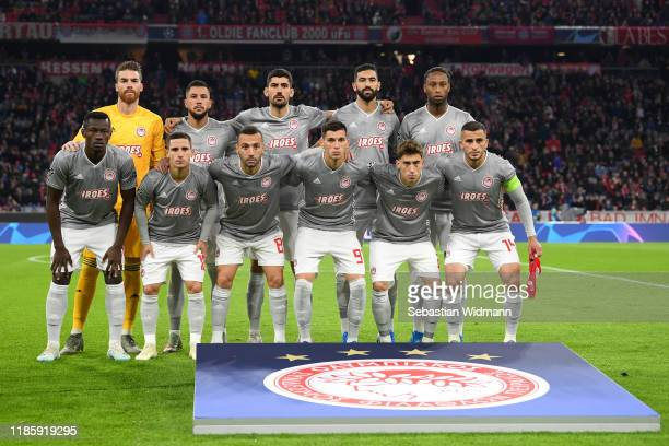 Members of the Olympiacos FC team line up for a photo prior to the UEFA Champions League group B match between Bayern Muenchen and Olympiacos FC at...