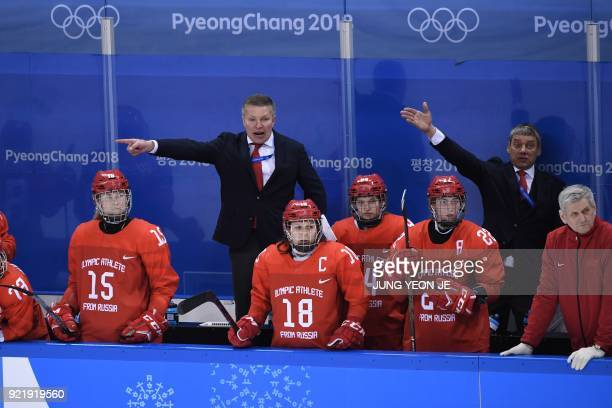 Members of the Olympic Athletes from Russia coaching staff direct their players in the women's bronze medal ice hockey match between Finland and the...
