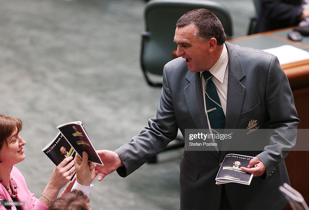 Members of the opposition hand in their props 'Tony Abbott's year of broken promises' during House of Representatives question time at Parliament House on December 4, 2014 in Canberra, Australia. Today is the official last day of sitting at Parliament for 2014. Parliament will return on February 9, 2015.