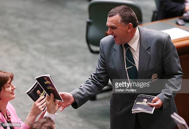 Members of the opposition hand in their props 'Tony Abbott's year of broken promises' during House of Representatives question time at Parliament...