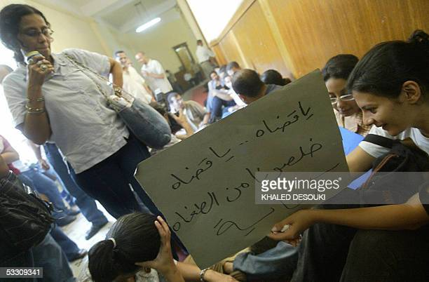 Members of the opposition Kefaya movement sit on the ground of the High Court's corridors in Cairo 31 July 2005 as they continue an unprecedented...
