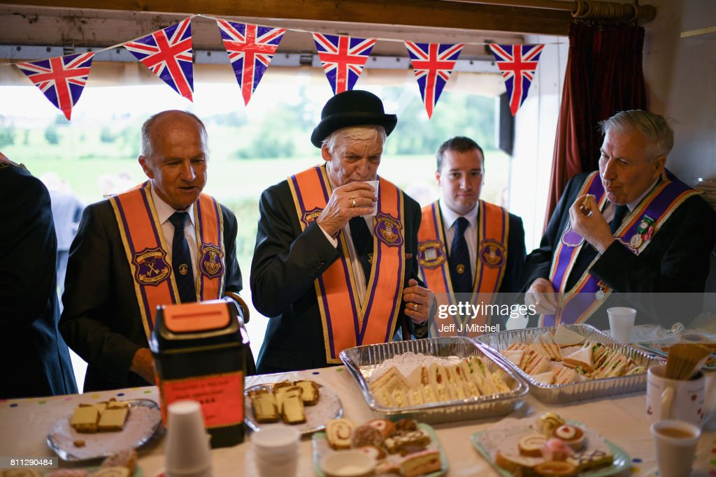 Members of the Orange Order have tea and sandwiches following their weekly march at Drumcree Church on July 9, 2017 in Drumcree, Northern Ireland. The annual Orange marches and demonstrations will take place on the Twelfth of July to celebrate the Battle of the Boyne in 1690 when the Protestant King William of Orange defeated the Catholic King James II on the banks of the river Boyne.