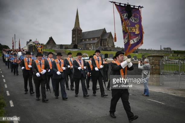 Members of the Orange Order hold a prayer service during their weekly protest at Drumcree Church on July 9, 2017 in Drumcree, Northern Ireland. The...