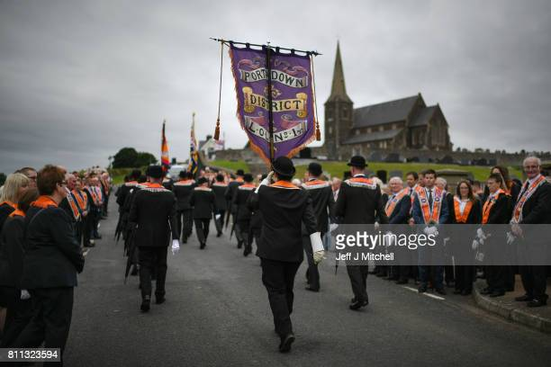 Members of the Orange Order march off following a prayer service during their weekly protest at Drumcree Church on July 9, 2017 in Drumcree, Northern...
