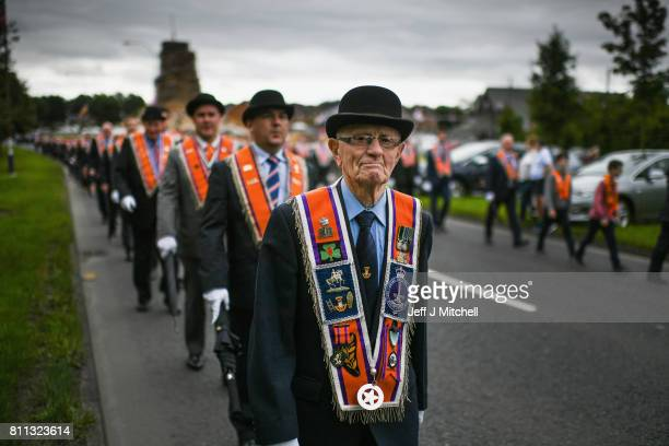 Members of the Orange Order march to Drumcree Church on July 9 2017 in Drumcree Northern Ireland The annual Orange marches and demonstrations will...