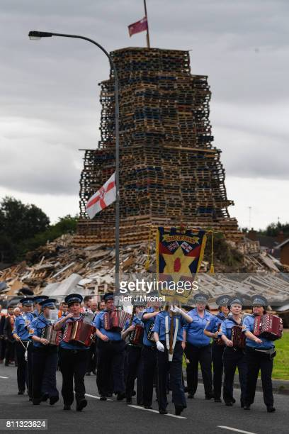 Members of the Orange Order march to Drumcree Church on July 9, 2017 in Drumcree, Northern Ireland. The annual Orange marches and demonstrations will...