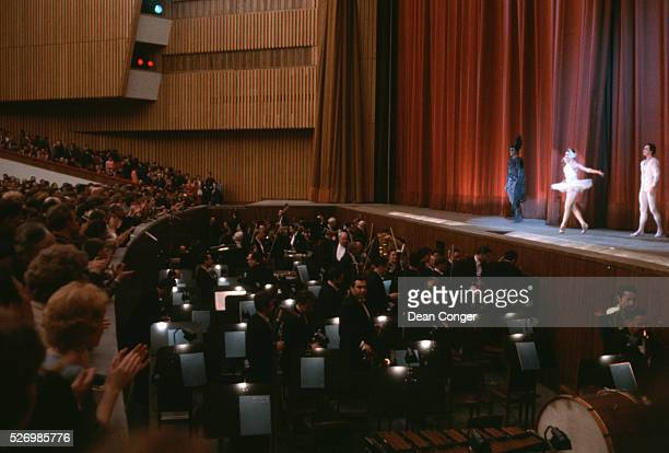 Members of the orchestra exit the pit as performers take a final bow on the theater stage in the Kremlin's Palace of the Congresses   Location Palace...