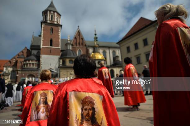 Members of the Order of Knights of Christ the King seen during a Corpus Christi mass outside Wawel Castle in Krakow. The Feast of Corpus Christi,...