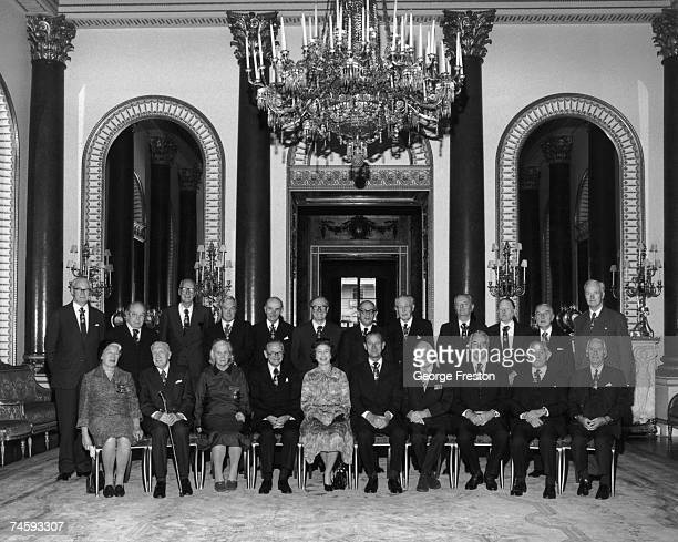 Members of the Order of Merit pose in the music room of Buckingham Palace where they are attending a luncheon 17th November 1977 From left to right...