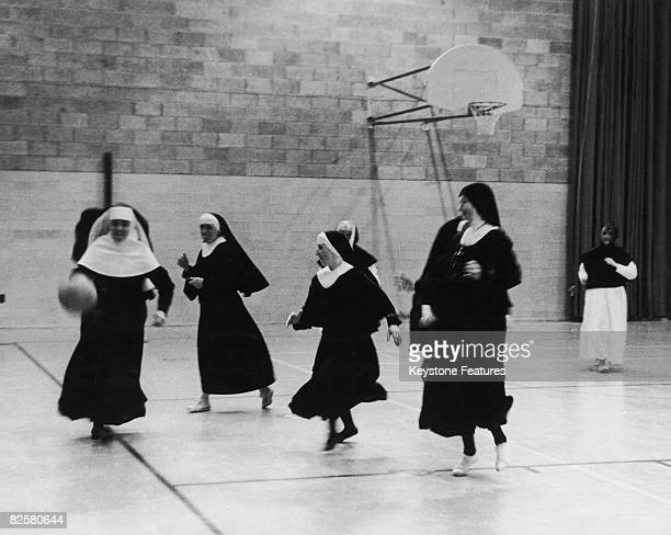 Members of the Order Of The Sisters Of The Cross training on a basketball court at the College Saint-Laurent in Montreal, Canada, July 1962. The nuns...
