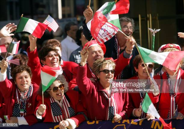 Members of the Order of the Sons of Italy cheer on the marchers as the 60th annual Columbus Day Parade proceeds up Fifth Ave