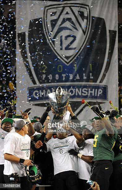 Members of the Oregon Ducks celebrate winning the Pac12 Championship against the UCLA Bruins at Autzen Stadium on December 2 2011 in Eugene Oregon...