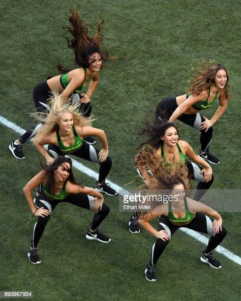 Members of the Oregon Ducks cheer team perform during the Ducks' game against the Boise State Broncos in the Las Vegas Bowl at Sam Boyd Stadium on...