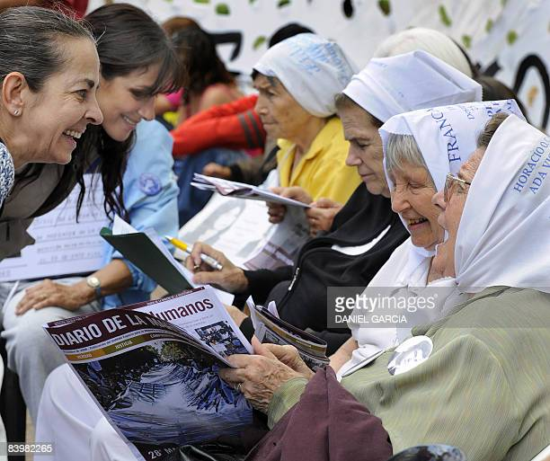 Members of the organization Mothers of Plaza de Mayo talk to passerby women at the beginning of the 28th March of Resistance of Mothers and...