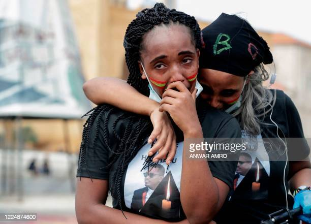 Members of the Oromo Ethiopian community in Lebanon mourn as they take part in a demonstration to protest the death of musician and activist Hachalu...