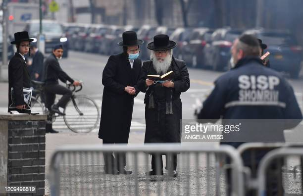 Members of the Orthodox Jewish community gather on April 8 2020 in Brooklyn New York as the Passover holiday starts Wednesday evening and runs to...