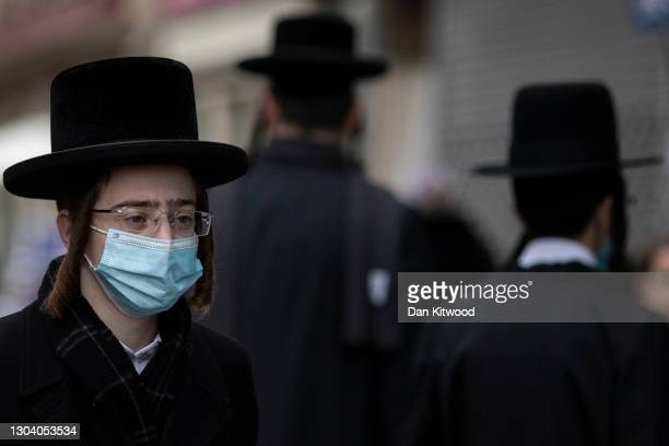 Members of the Orthodox Jewish community in Stamford Hill, ahead of Purim on February 25, 2021 in London, England. Last year's Purim occurred before...