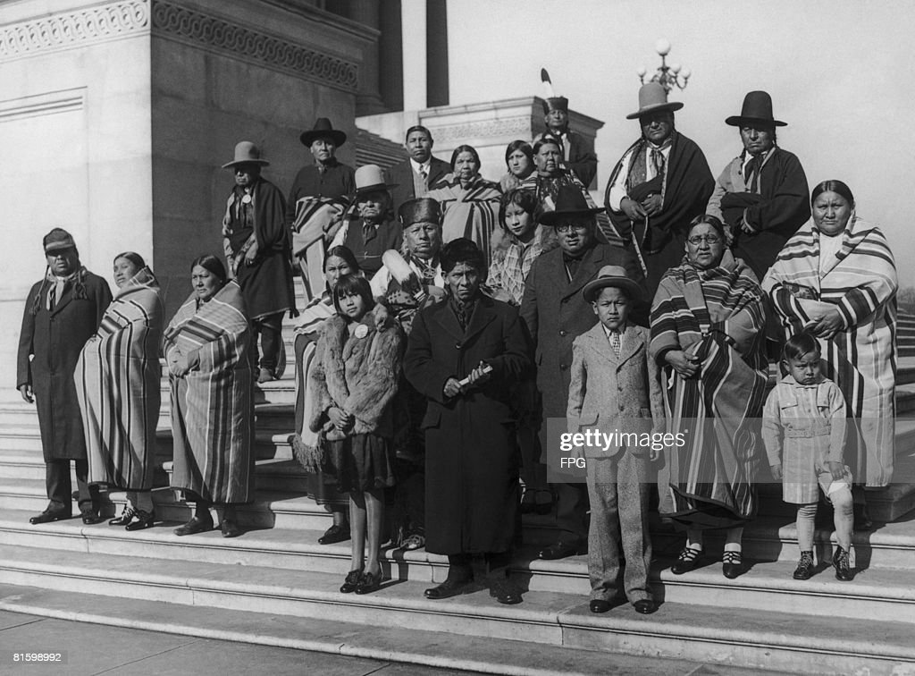Members of the Osage Nation from Oklahoma on the steps of the Capitol in Washington D.C., during a visit to lobby senators over conditions among Native Americans in Oklahoma, and also regarding their oil leases, circa 1925.