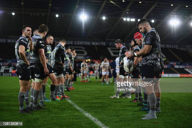 Members of the Ospreys side cut dejected figures after defeat to Worcester Warriors during the Challenge Cup match between Ospreys and Worcester...