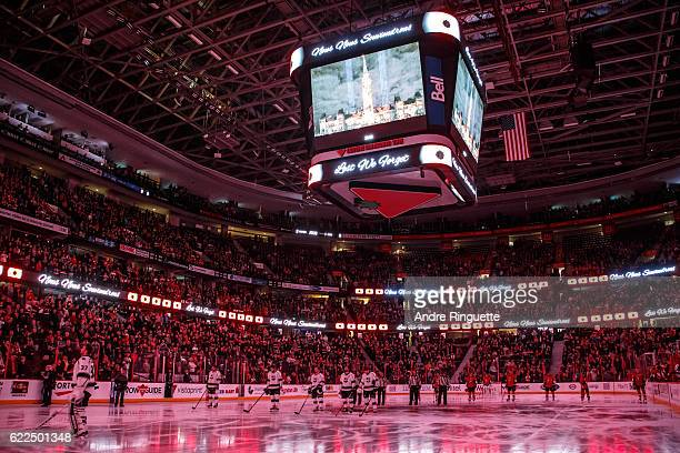 Members of the Ottawa Senators and the Los Angeles Kings stand at attention during a Remembrance Day tribute at Canadian Tire Centre on November 11...