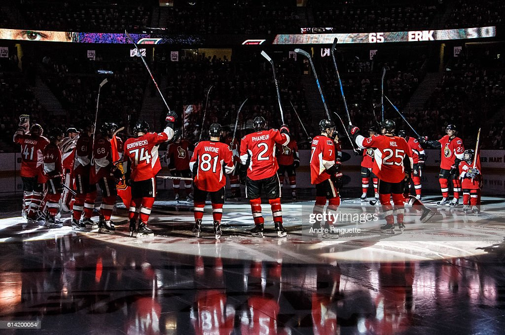 Members of the Ottawa Senators including Mark Borowiecki #74, Phil Varone #81, Dion Phaneuf #2, Kyle Turris #7 and Chris Neil #25 salute the fans from center ice during player introductions prior to a game against the Toronto Maple Leafs at Canadian Tire Centre during the season opener on October 12, 2016 in Ottawa, Ontario, Canada.
