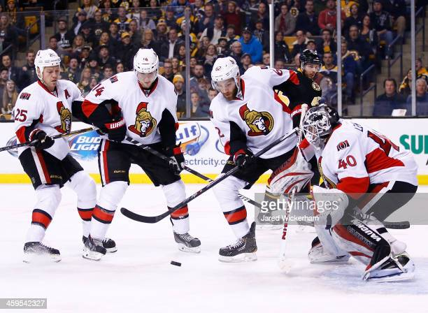 Members of the Ottawa Senators including Robin Lehner Eric Gryba Colin Greening and Chris Neil watch a loose puck in front of the net against the...
