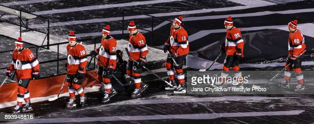 Members of the Ottawa Senators make their way to the ice surface just prior to the start of their game against the Montreal Canadiens during the of...