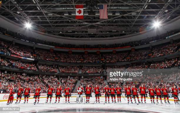 Members of the Ottawa Senators observe a moment of silence at the blue line prior to their home opener the Washington Capitals at Canadian Tire...