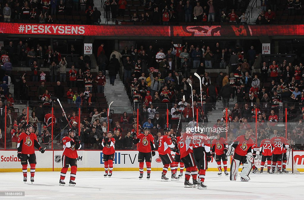 Members of the Ottawa Senators raise their sticks to salute the crowd after a win against the New York Rangers on March 28, 2013 at Scotiabank Place in Ottawa, Ontario, Canada.