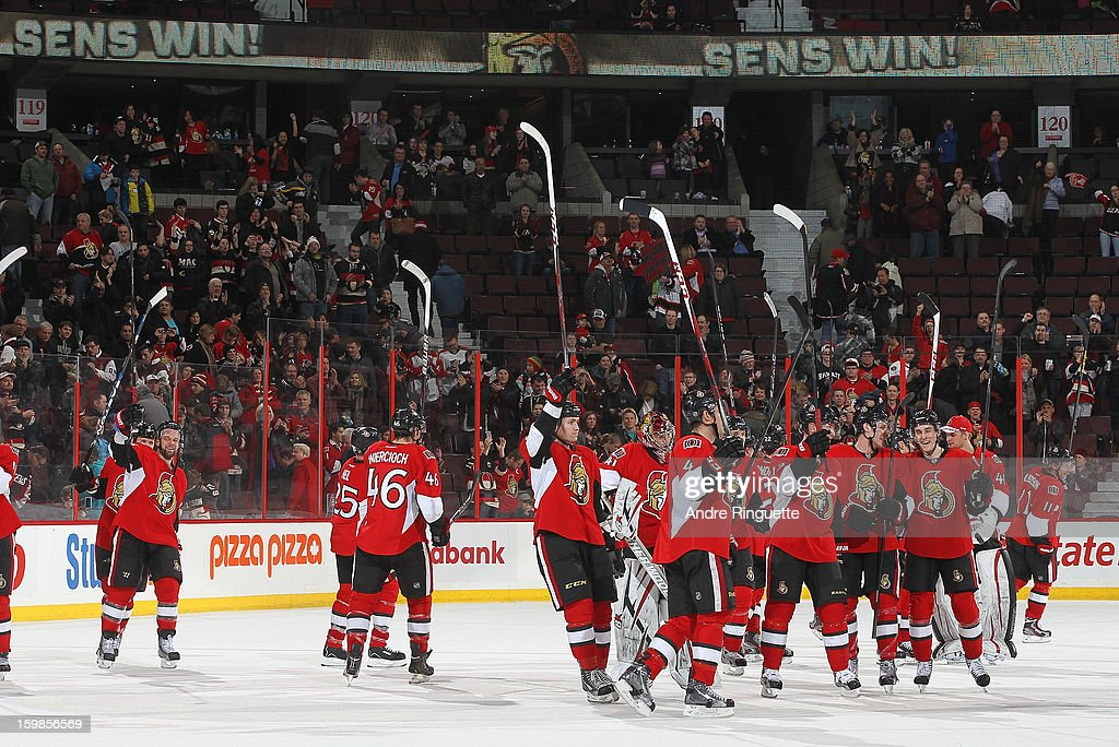 Members of the Ottawa Senators raise their sticks to salute the fans after their 4-0 win against the Florida Panthers on January 21, 2013 at Scotiabank Place in Ottawa, Ontario, Canada.