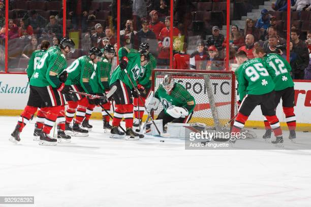 Members of the Ottawa Senators warm up in green jerseys for St Patrick's Day prior to a game against the Dallas Stars at Canadian Tire Centre on...