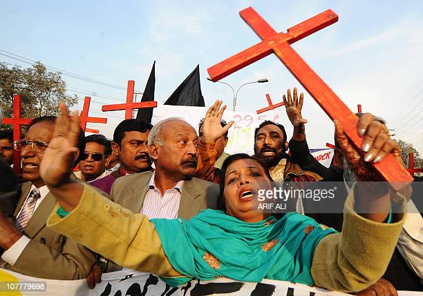 Members of the Pakistan Christian Democratic alliance march during a protest in Lahore on December 25 in support of Asia Bibi a Christian mother...