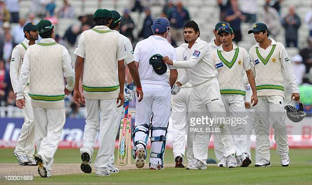 Members of the Pakistan team congratulate England batsman Andrew Strauss after losing the second NPower Test cricket match at Edgbaston in Birmingham...