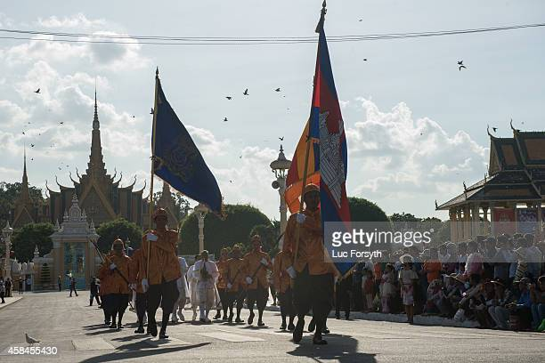 Members of the palace guard escort Brahmin priests from the royal palace to the river where the day's races will be held during the Water Festival on...