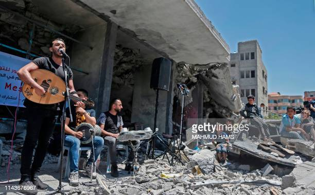 TOPSHOT Members of the Palestinian band Dawaween perform during a musical event calling for a boycott of the Eurovision Song Contest hosted by Israel...