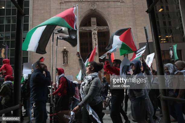 Members of the Palestinian community and their supporters march toward the Israeli consulate to protest President Donald Trump's decision to move the...