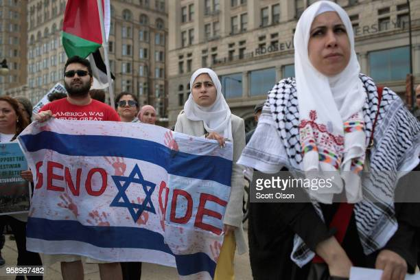 Members of the Palestinian community and their supporters protest President Donald Trump's decision to move the US embassy in Israel from Tel Aviv to...