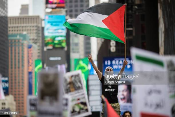 Members of the Palestinian community, fellow Muslims and their supporters rally in support of the Palestinian people in the wake of the recent...