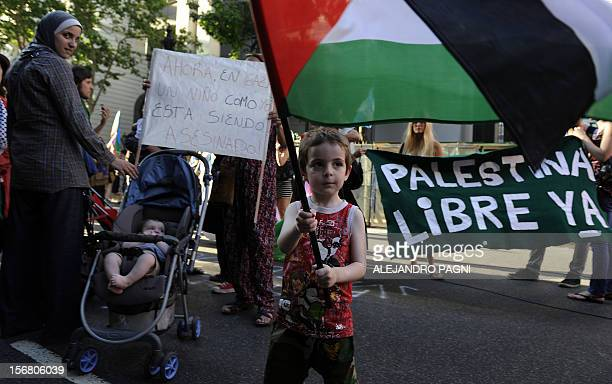 Members of the Palestinian community in Argentina take part in a demonstration against Israeli strikes in Gaza in front of Israel's Embassy in Buenos...